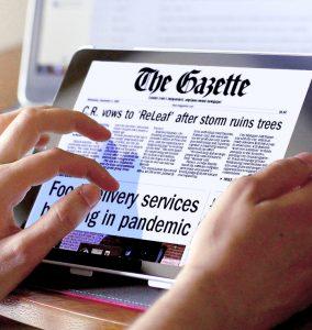 Reader using green gazette digital edition on tablet